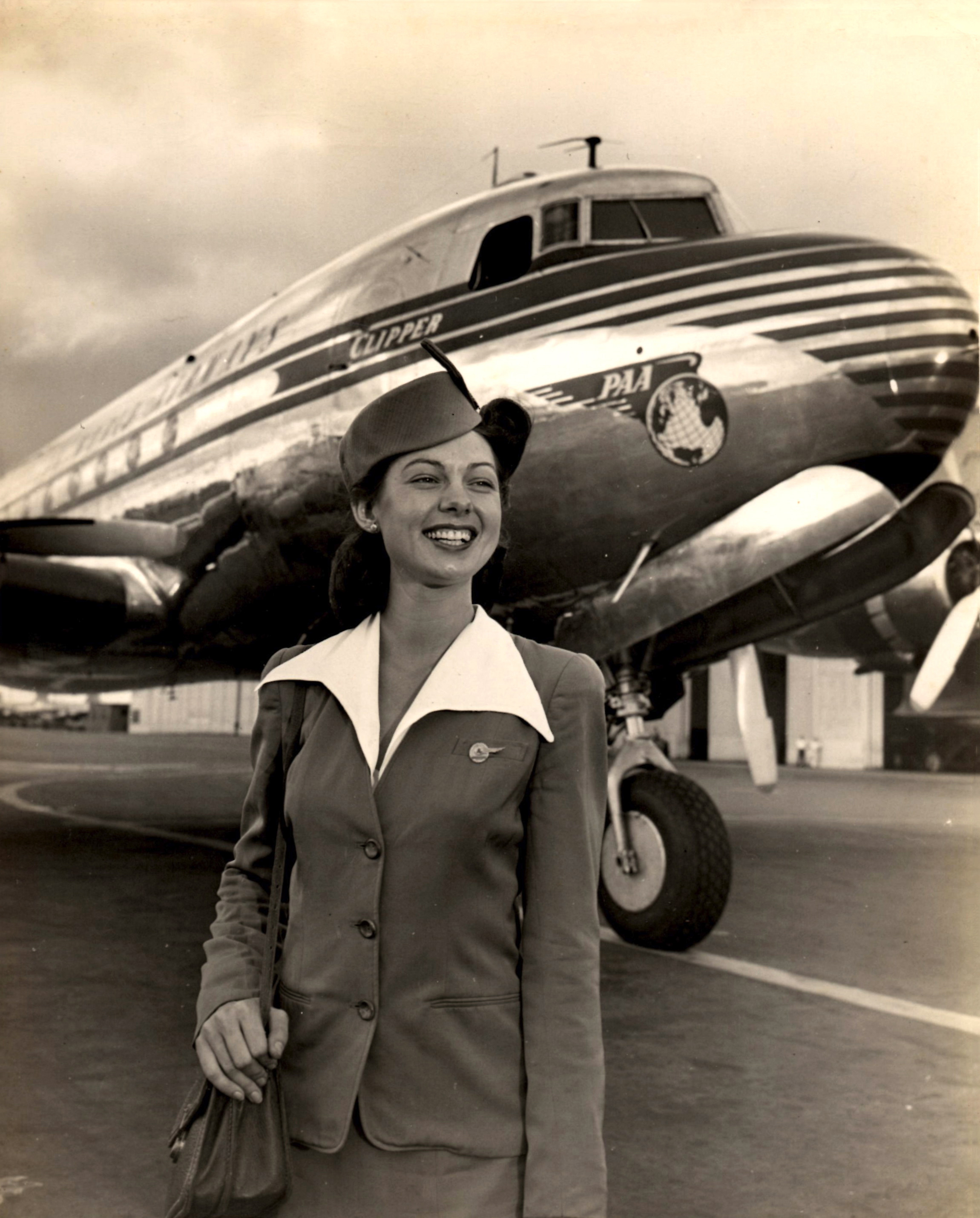 Doris stands proud in her uniform in front of a Pan American Airways DC-4