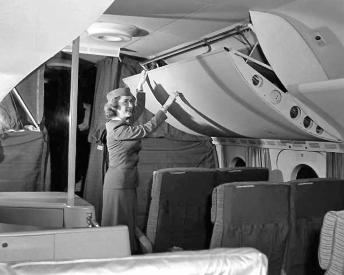 "No, those aren't ""superbins."" The B-377 Stratocruiser offered passengers complete comfort with pull-down sleeping berths."