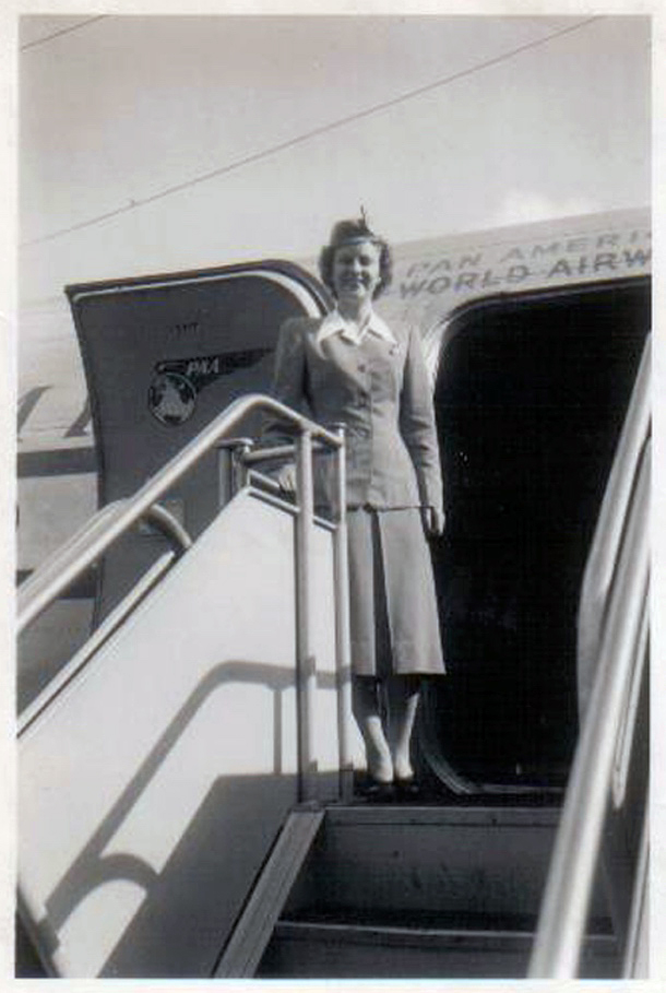 Lynn Oberle ready to greet passengers aboard a DC-4 .